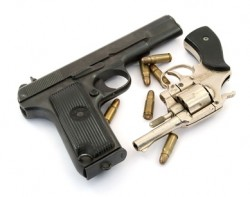 Pistol & Revolver with scattered shells (image)